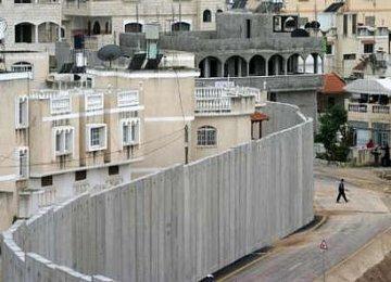 Apartheid wall next to house