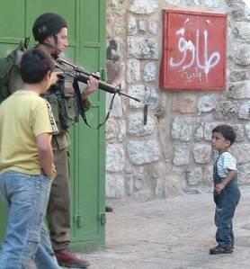 brave idf soldier points gun at toddler