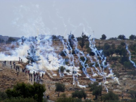 Teargas canisters shot by IDF at peaceful protesters in Bil'in.
