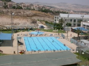 jew swimming pool with Palestine's water