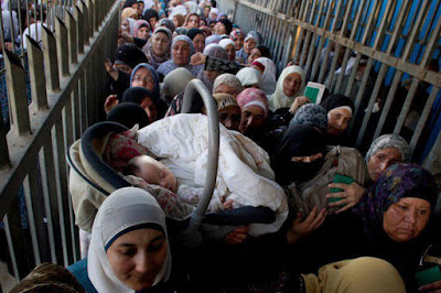 Palestinian women waiting at checkpoint