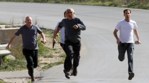 Armed violent Jewish settler colonists run to attack car