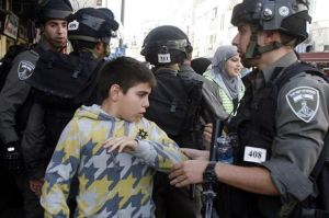 Brave Jewish soldiers accosting terrifying Palestinian child