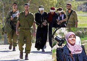 Brave Jewish soldiers leading blindfolded and handcuffed Palestinian ladies away