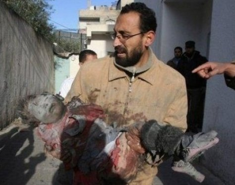 Father with child: a victim of Israel's viciousness