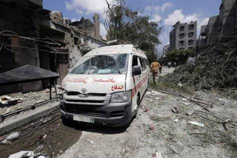 Gaza - 20 July ambulance attacked by Jewish military on way to Shujaiya. Mohammed Abed AFP