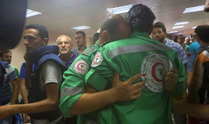 Gaza - 20 July - medics at al Shifa hospital mourn their colleague who was killed in Shujaiya