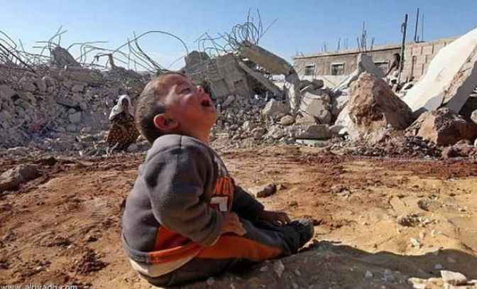 Gaza - 25 July toddler cries in front of rubble that used to be his home