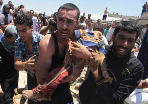 Gaza - carrying dead Palestinian child killed by Jewish airstrike on his home 9 July 2014 Reuters
