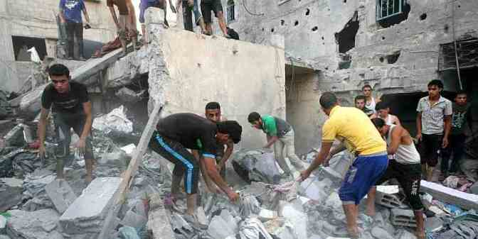 Gaza - Palestinians search for survivors in Rafah civilian home bombed by Jewish military 5 dead 15 wounded 11 July 2014. MEMO