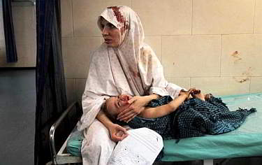 Gaza - woman and child in hospital