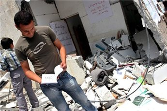 Gazan at rubble of Islamic University Gaza post Israeli destruction in 2006