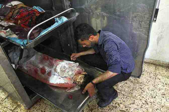 Gazan children in the morgue slaughtered by Jewish military 2014. APA images