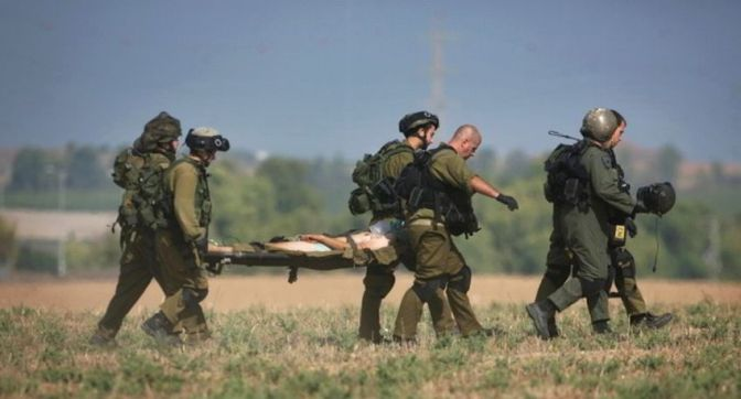 Invaders carrying one of their wounded on stretcher