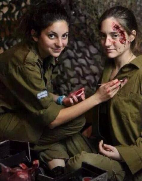 Jewish military girls using fake blood for fake injuries for the TV news