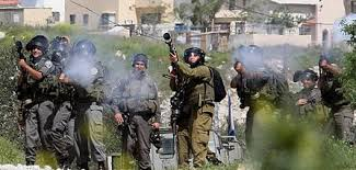 Jewish border police and military firing tear gas cannisters