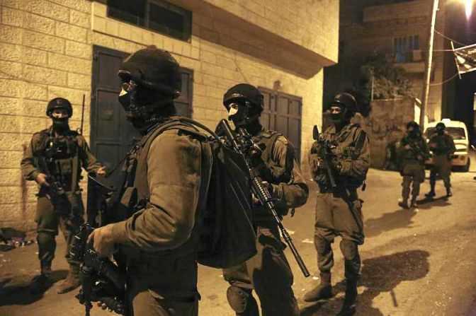 Jewish military night time raid. © Kelly Lynn