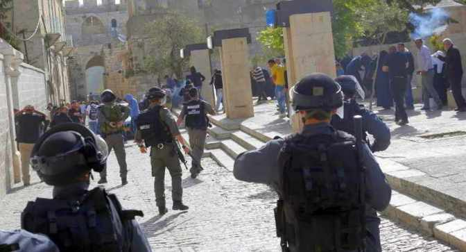 Jewish riot police attacking worshippers at al-Aqsa