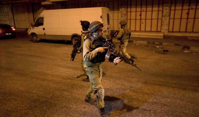 Jewish soldier on street at night guns out