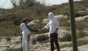 Jewish soldier shakes hand of violent Jewish settler colonist after attack on Palestinians