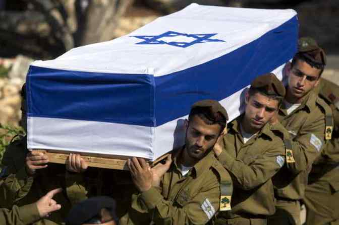 Jewish soldiers carrying coffin daytime