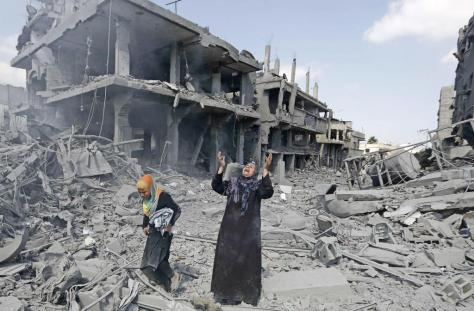 Palestinian lady crying in destroyed neighbourhood