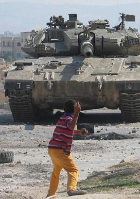 Little boy versus tank. Who is threatened here? Who has the power?