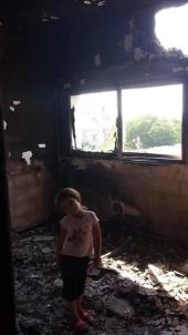 Little girl in her room - in house destroyed by Jewish military