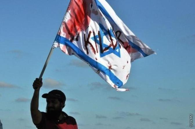 Maldives: man holding up Jewish military state flag - KILLER. Sun.mv