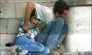 Mohammad al-Doura and father before being shot by Jewish sharpshooters