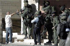 Palestinian man holds up hands in Shufat, Jerusalem, Palestine
