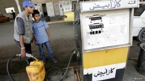 A Palestinian pumps gas