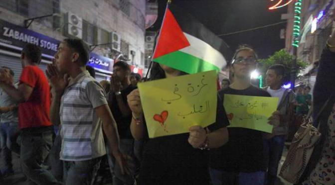 West Bank Palestinians rally for embattled Gaza