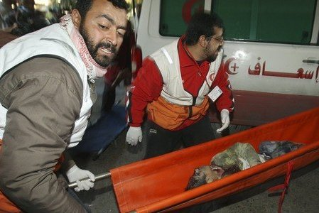 Red Crescent take away 2 year old blown to bits by Israel