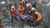 rescuers uncover another body