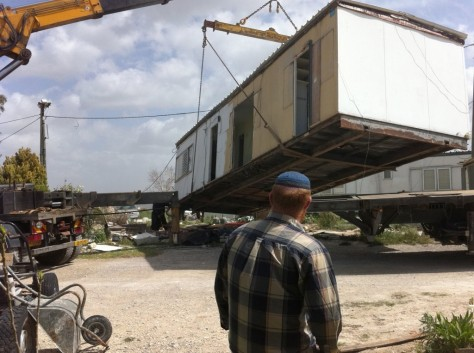 Trailer being placed for illegal Jewish settlement colony