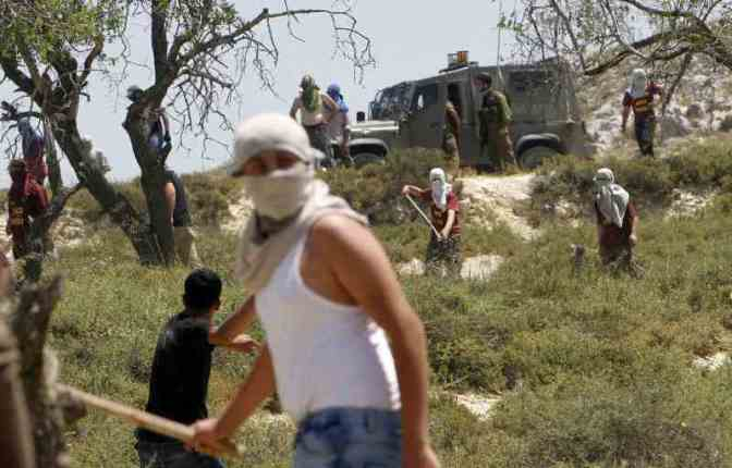 Violent Jewish settler colonists armed with clubs, slings attack Palestinians with Jewish soldiers protection