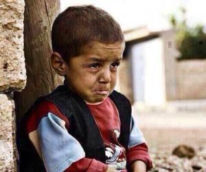 Gaza - tiny little boy trying to be brave by himself