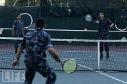 Officers playing tennis doubles