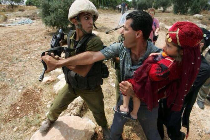 Palestinian father protecting daughter