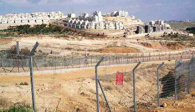 Illegal Jewish settlement colony and concertina wire